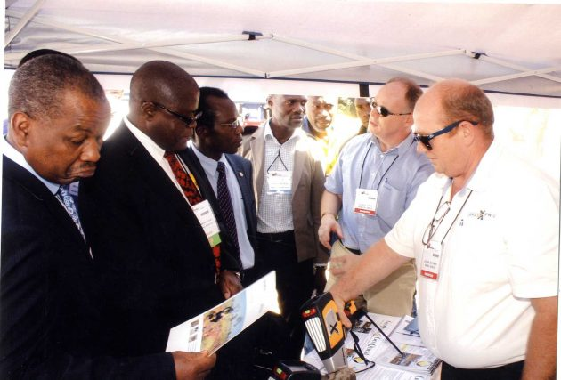 The Honourable Christopher Yaluma, Minister of Mines and Mineral Development, Republic of Zambia and Senior Government Officials being given a demonstration of hand held XRF technology by Julian Green of GeoQuest Ltd and Stuart Bateman of Innov-X South Africa